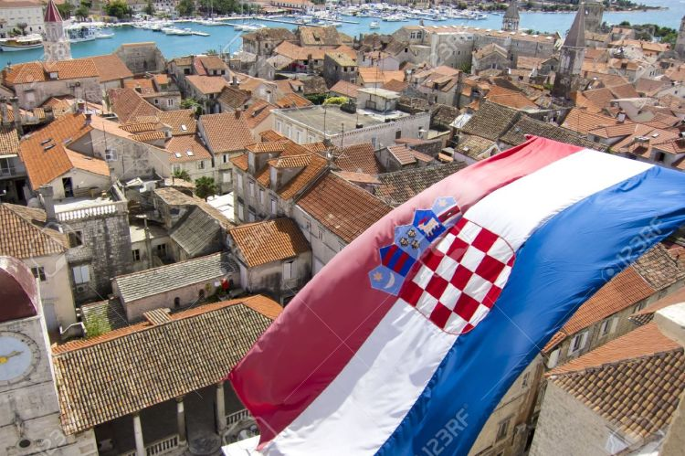 14503470-croatian-flag-on-the-city-of-trogir-in-dalmatia-Stock-Photo